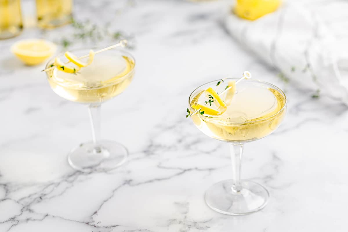 limoncello thyme spritzer in coupe glasses