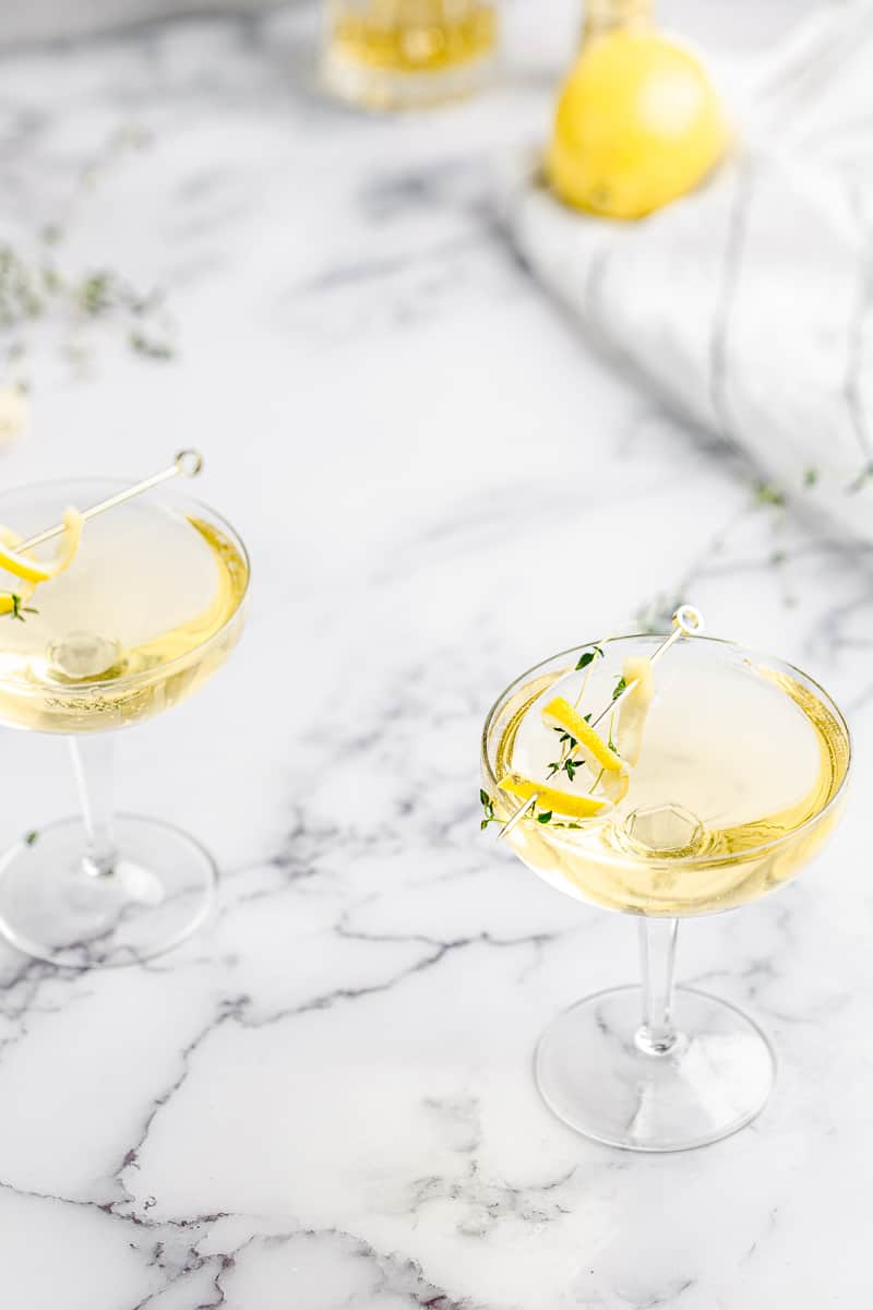 limoncello thyme spritzer in a coupe glass