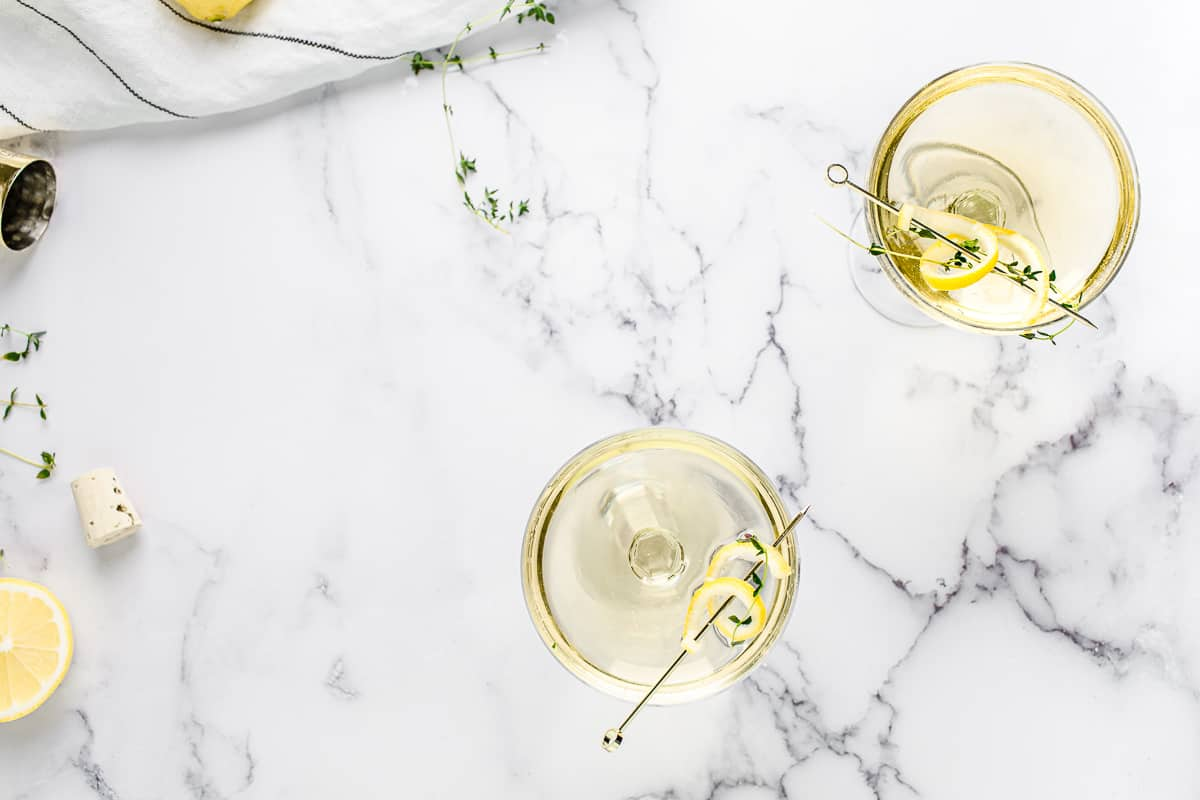 limoncello thyme spritzer in a coupe glass - overhead