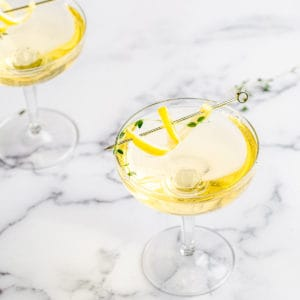 glasses of limoncello thyme spritzer on marble