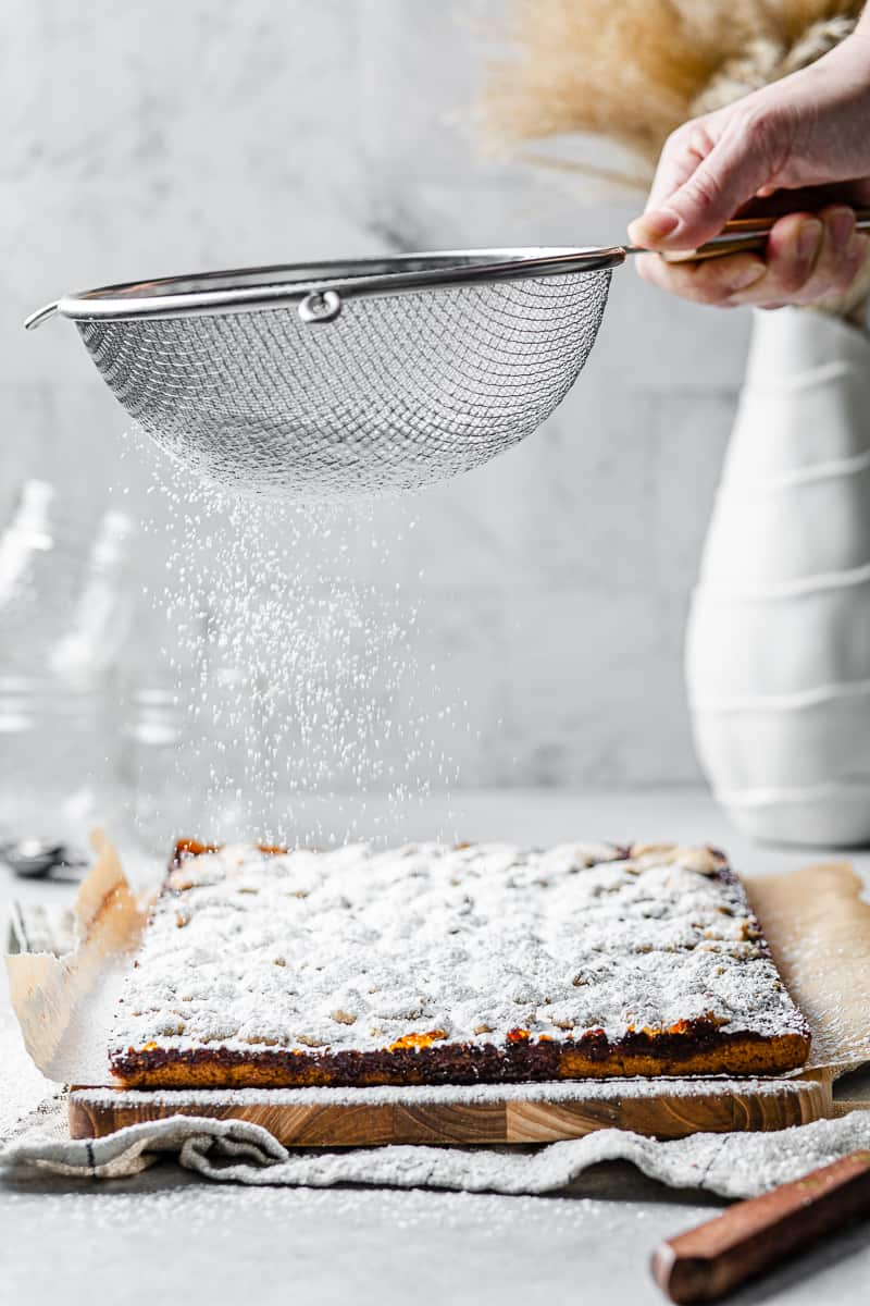 sprinkling powdered sugar over the finished bars