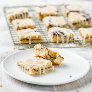 glazed snickerdoodle bars on a plate