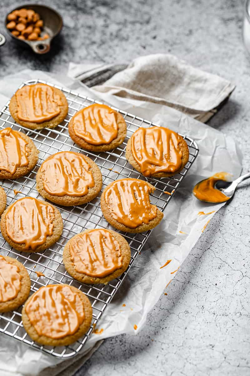 butterscotch cookies with fresh glaze on a cooling rack