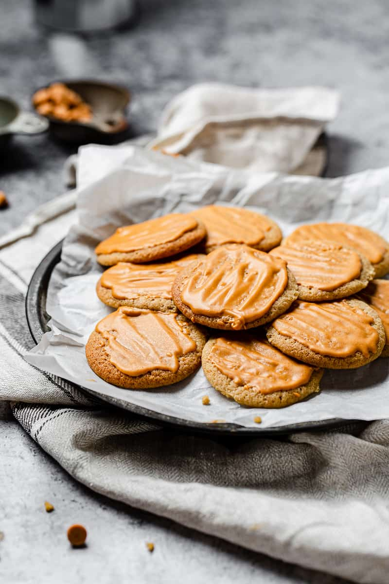 butterscotch cookies with glaze on top on a platter