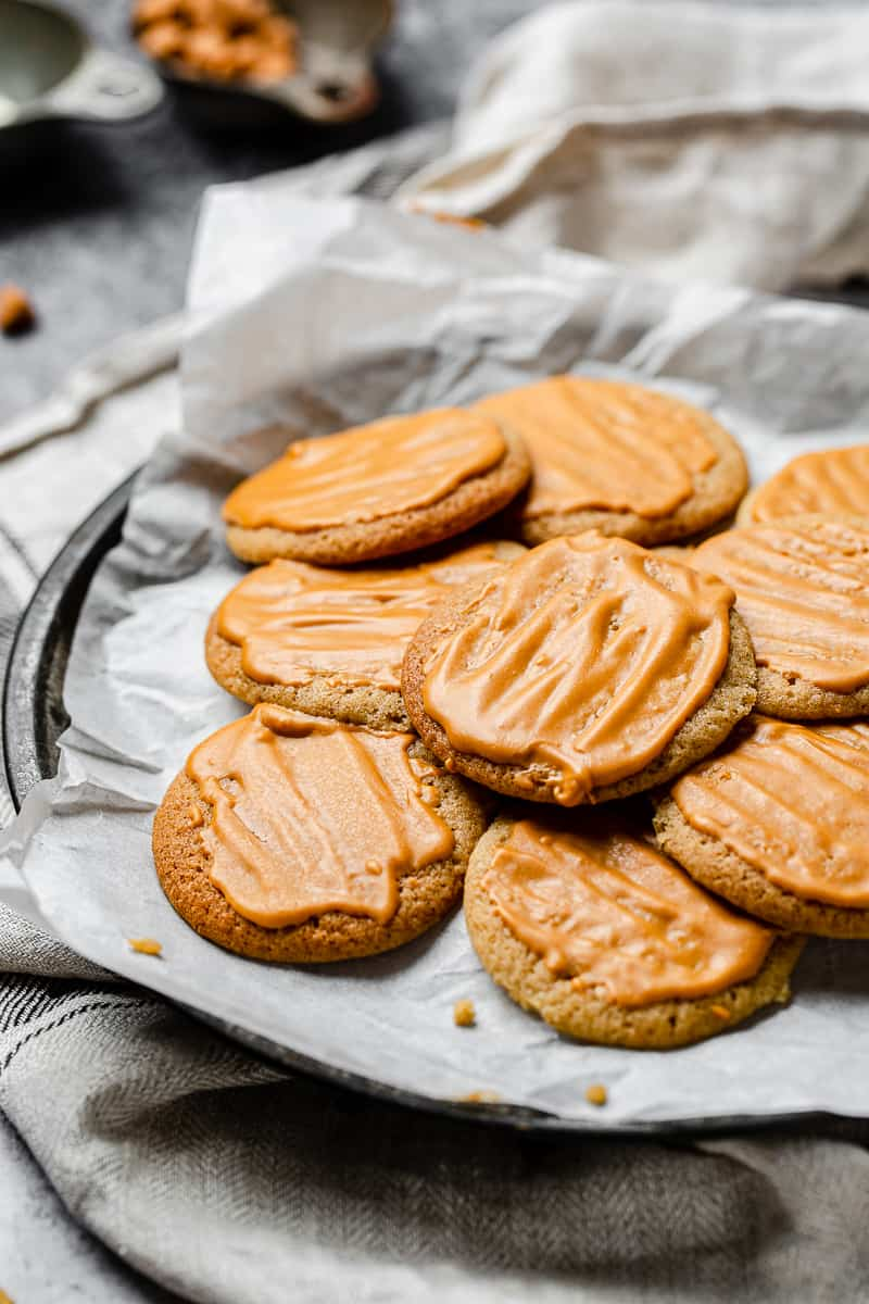 chewy butterscotch cookies with glaze on a platter