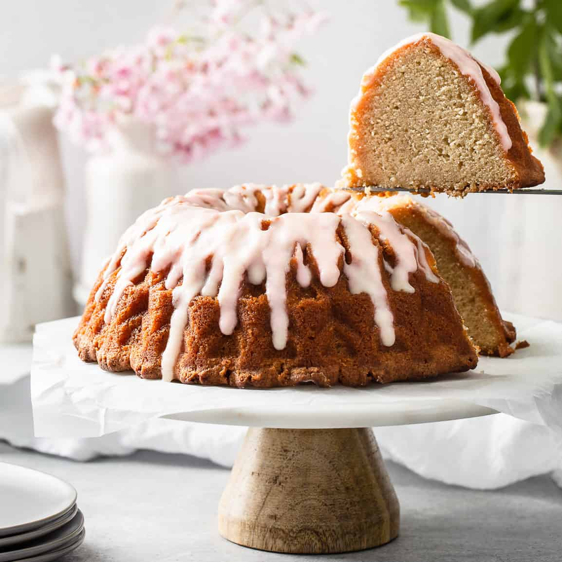 bundt cake with a slice being taken out