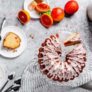 overhead view of table arrangement with blood orange pound cake and cake slices on plates