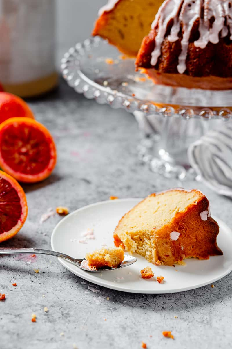 slice of blood orange pound cake with a bite taken out of it