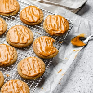 putting glaze onto chewy butterscotch cookies