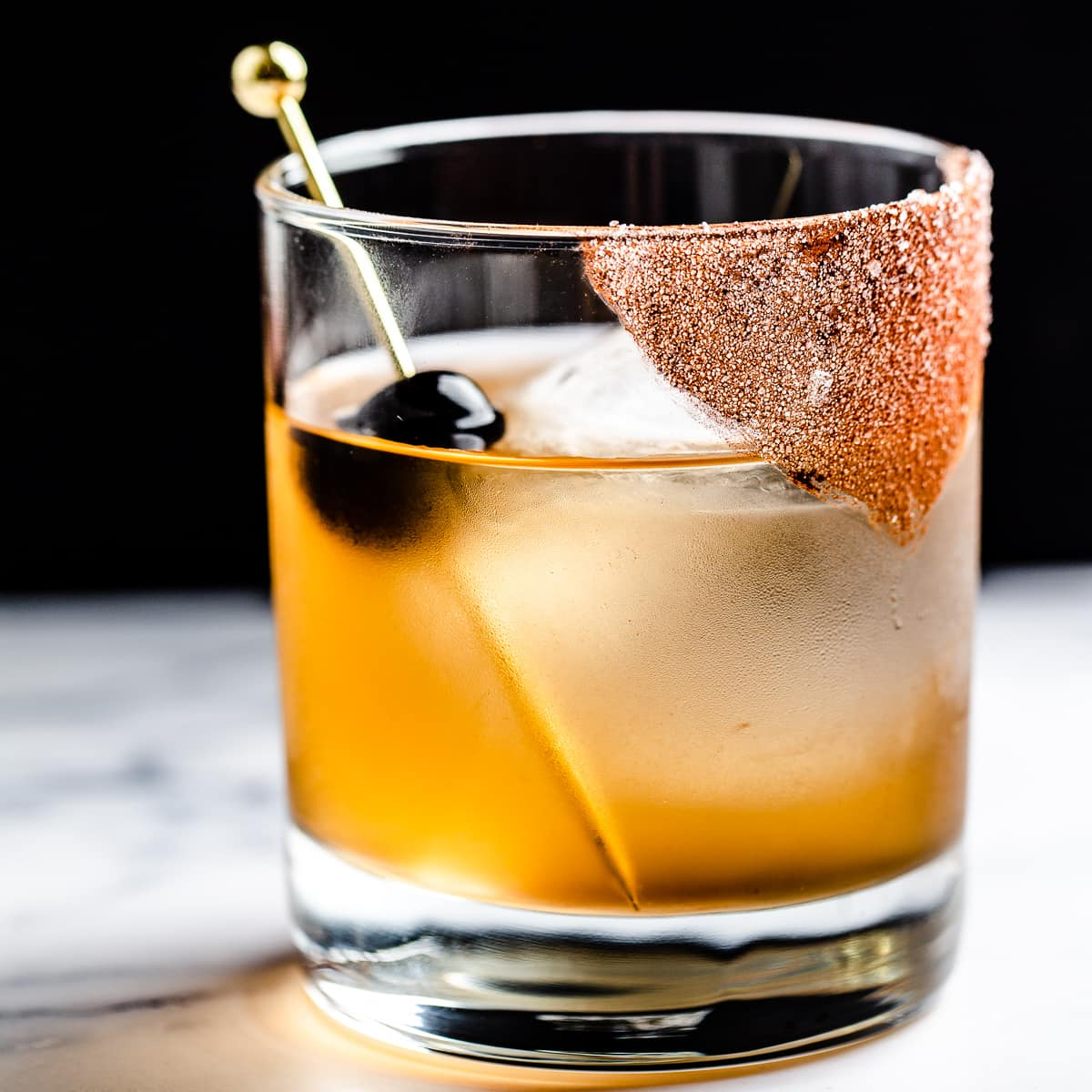 close up of mezcal cocktail with cocoa sugar on half of the rim