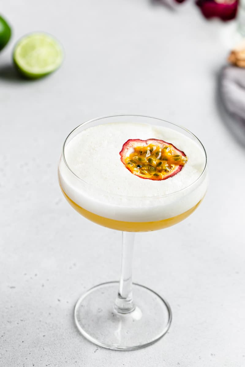 overhead view of passionfruit mango sour cocktail