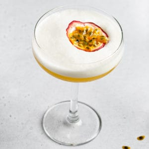 top view of Passionfruit Mango Sour with passionfruit garnish