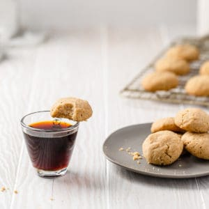 Swedish dream cookies on a plate and one balanced on an espresso cup