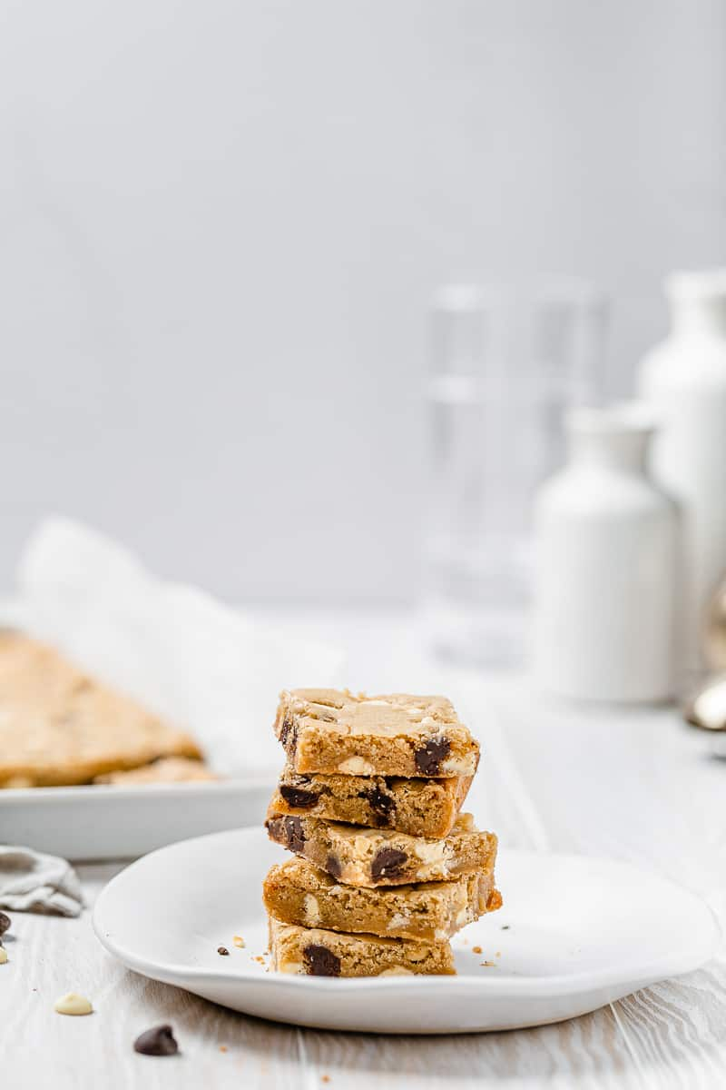 stack of blondies on a plate with baking tray
