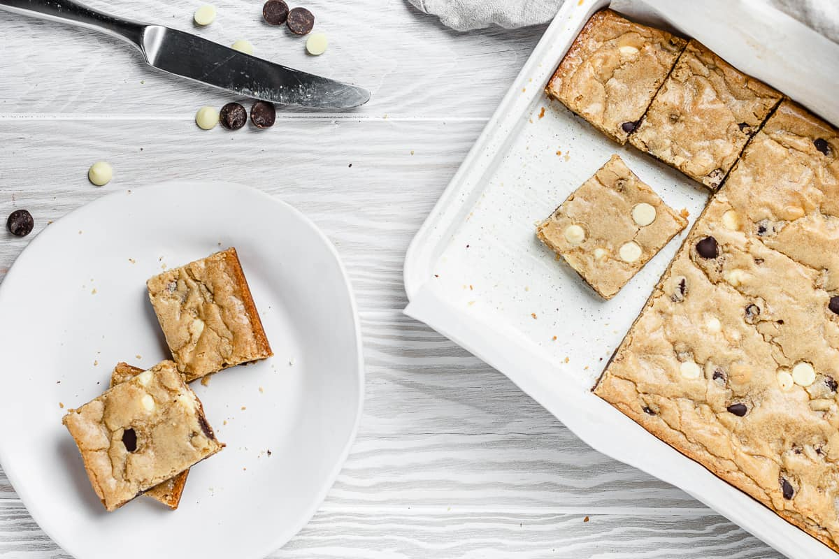 overhead shot of blondies in a baking tray and on a plate