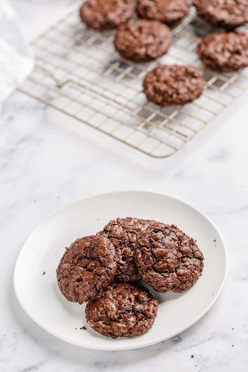 chocolate cookies piled up on a plate