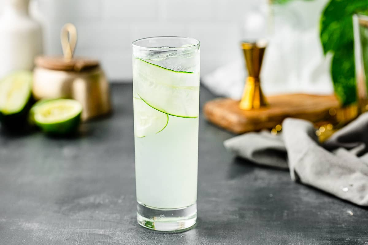 horizontal image of cucumber gin cocktail in highball glass