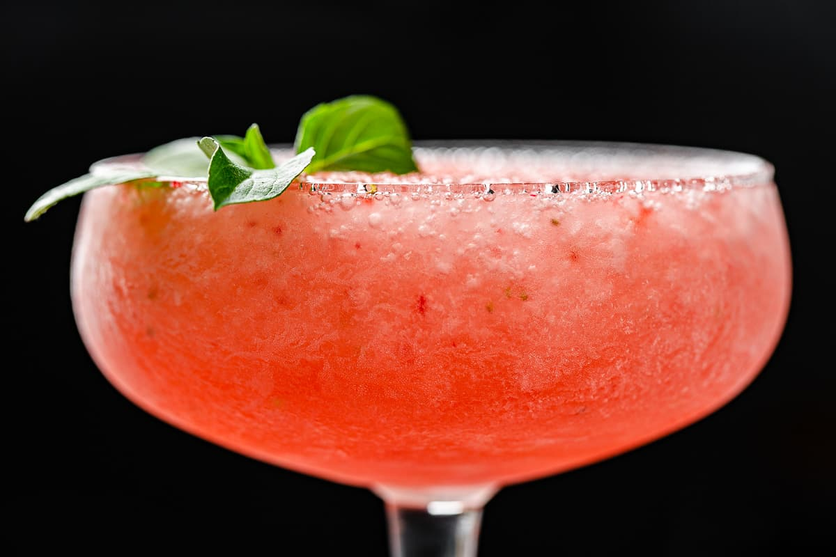 side view closeup of frozen strawberry cocktail in a coupe glass