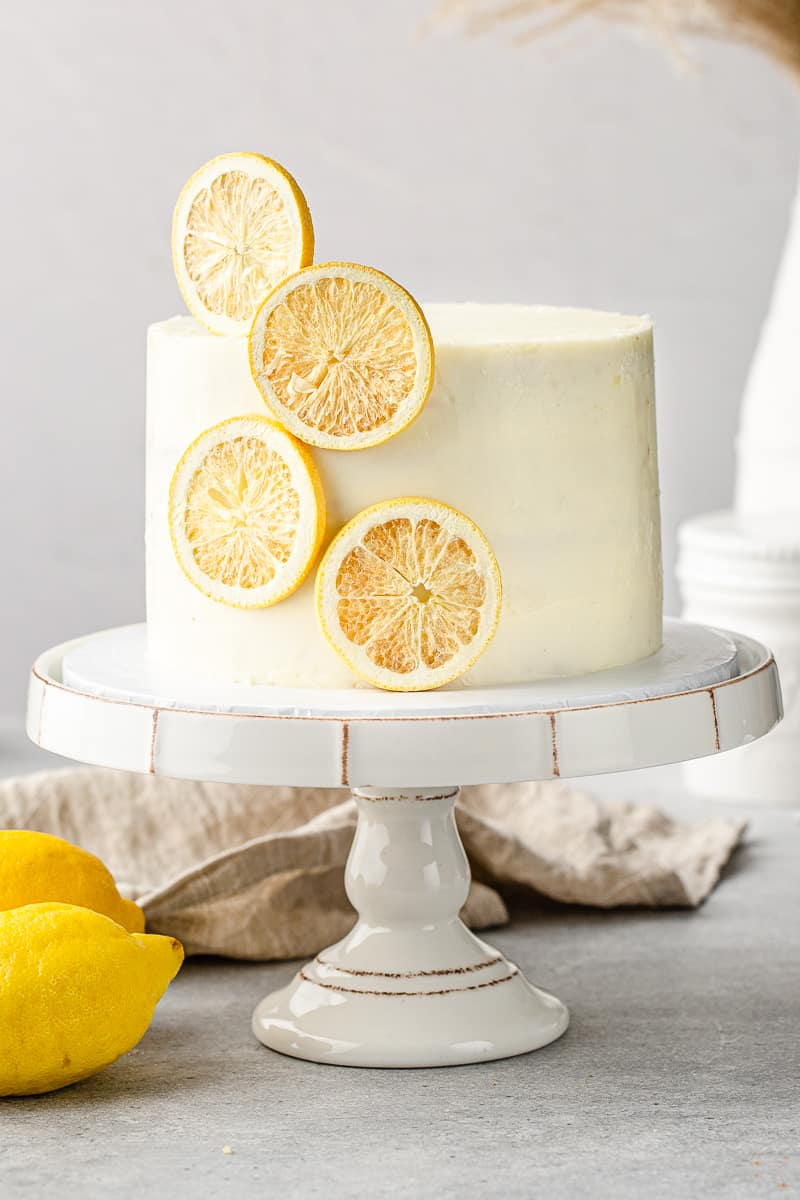 front view of the lemon layer cake on a cake stand