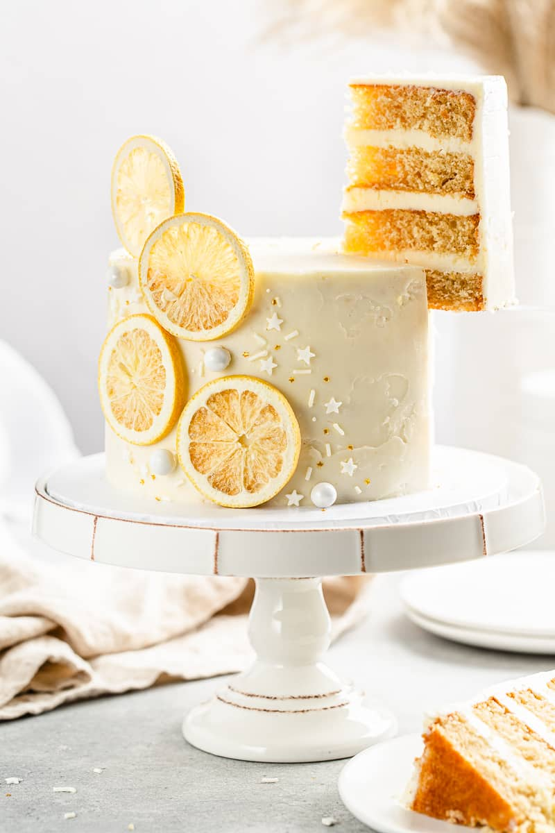lifting a slice out of the lemon layer cake