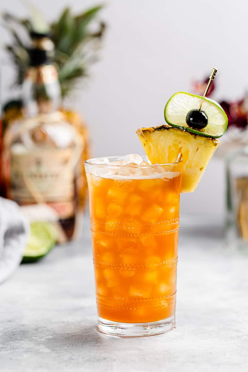 Rum and Ramazzotti cocktail, a take on the classic Jungle Bird cocktail, in a tall glass with lots of ice