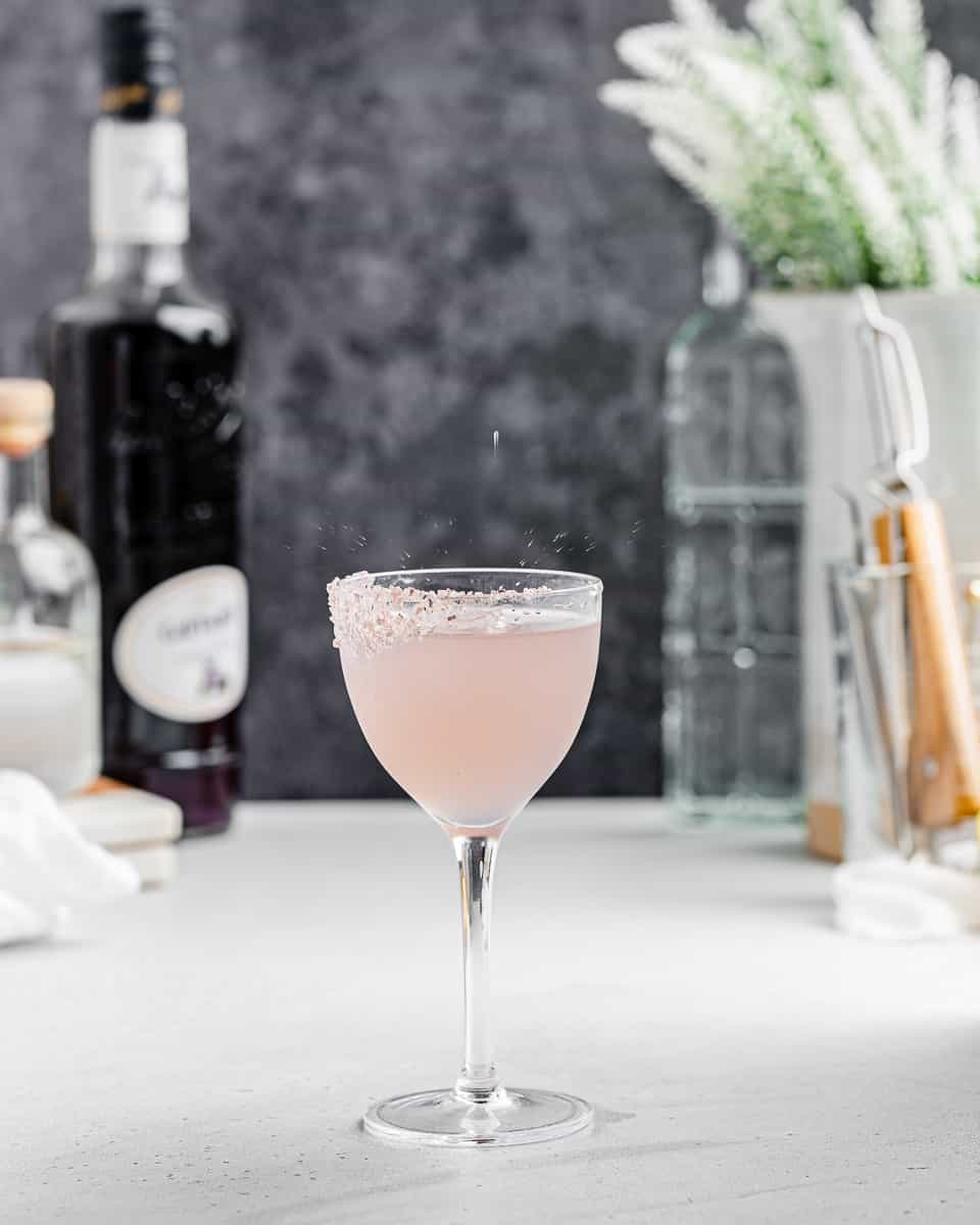Gin and Violet cocktail with sugar rim