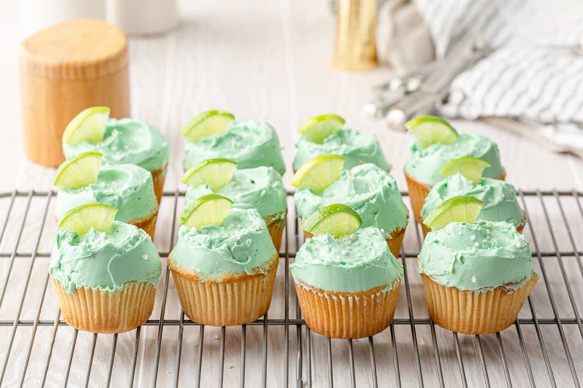 rows of margarita cupcakes on a cooling rack