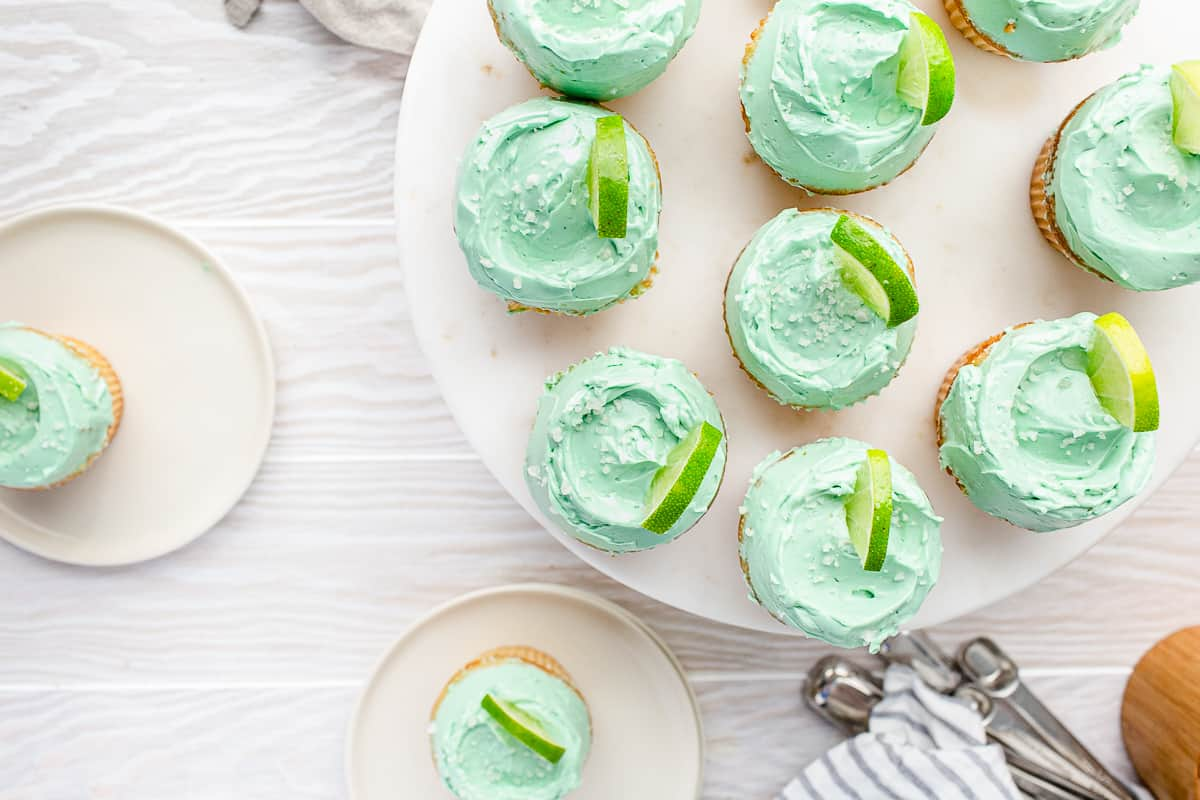 overhead shot of cupcakes on a cake stand with two on plates