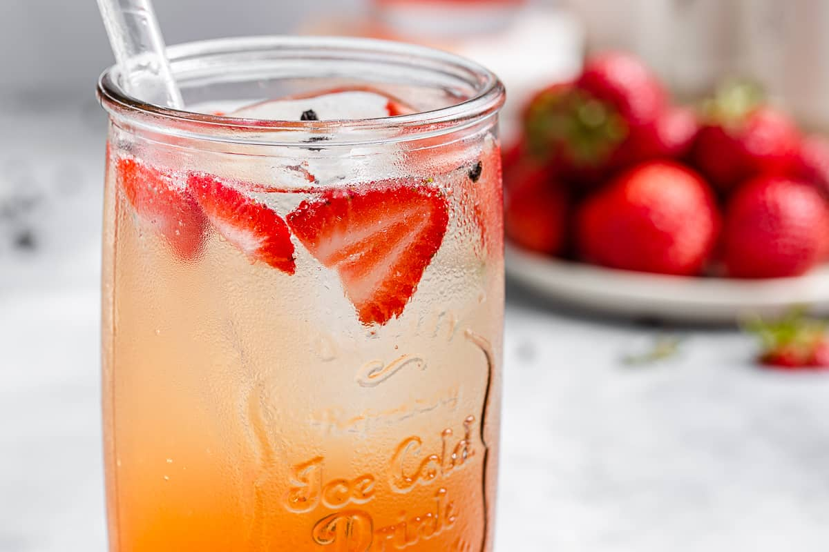 close up of strawberries in cocktail