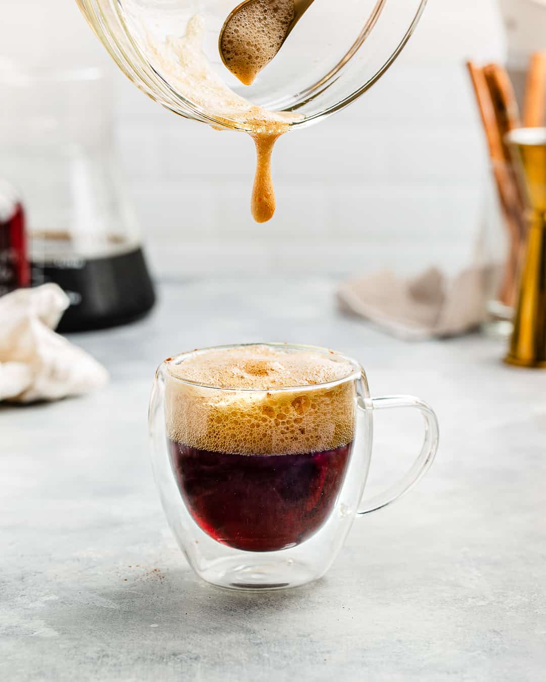 Coffee foam dripping into the cocktail