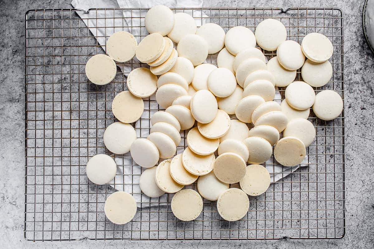 overhead shot of macarons on a cooling rack
