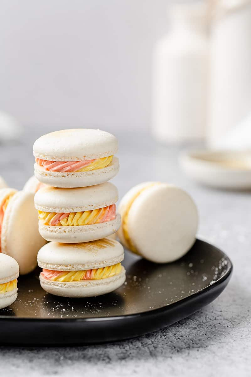 stack of macarons on a black plate
