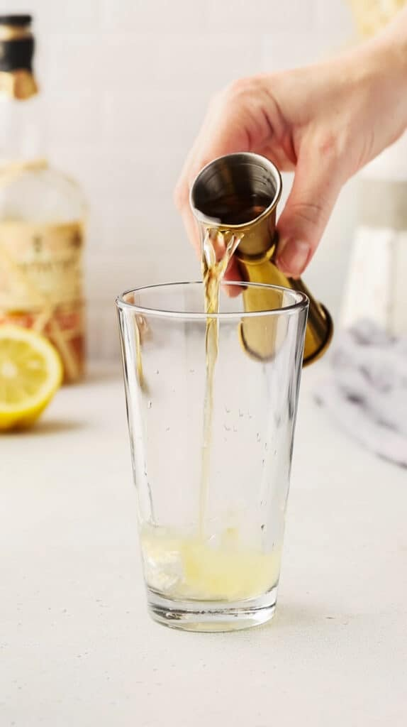 adding sherry to the cocktail