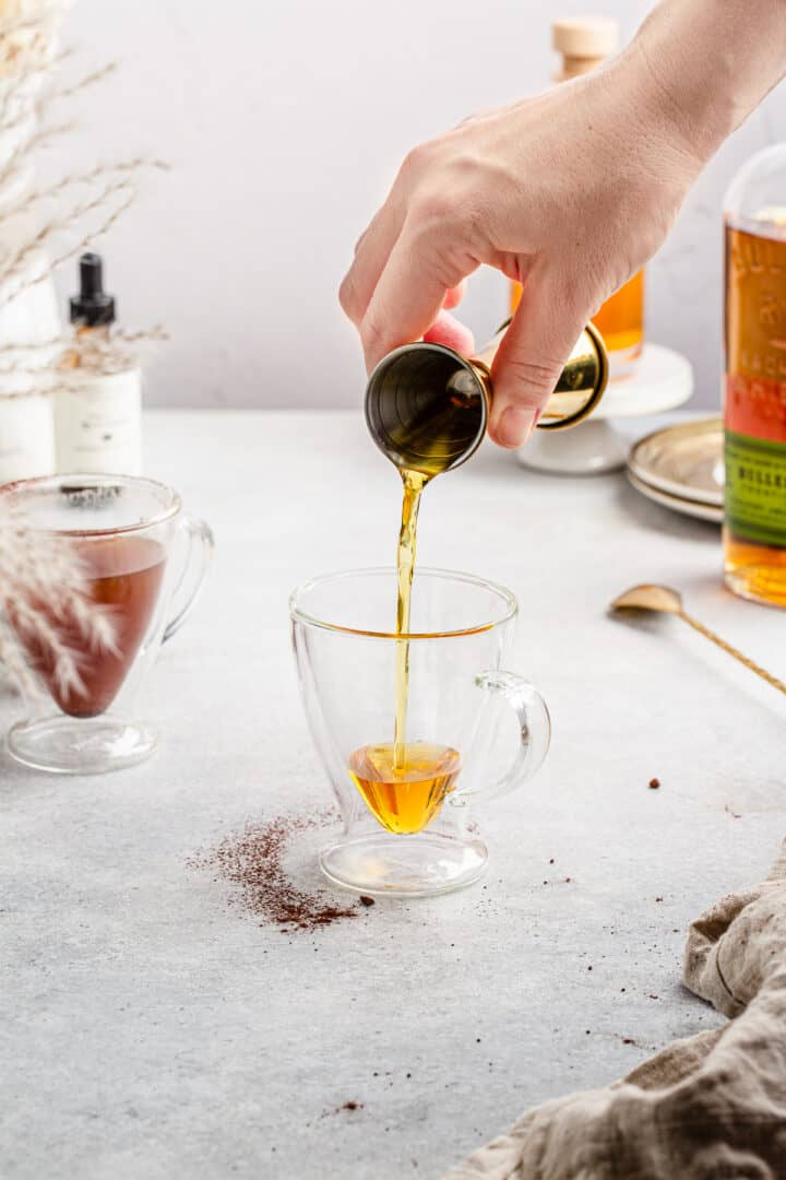 pouring caramel sauce into glass