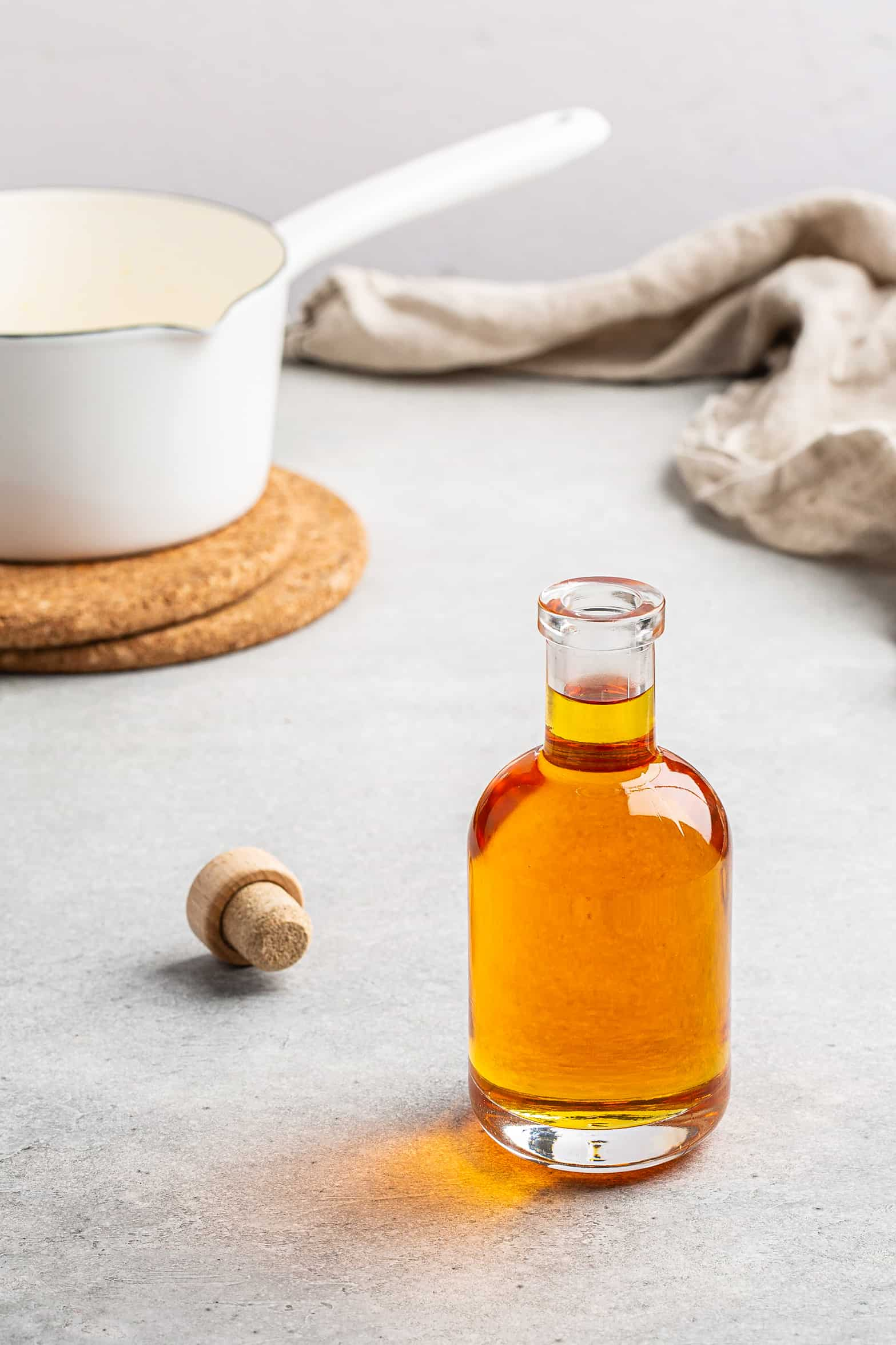 caramel syrup in a bottle with white pan in background