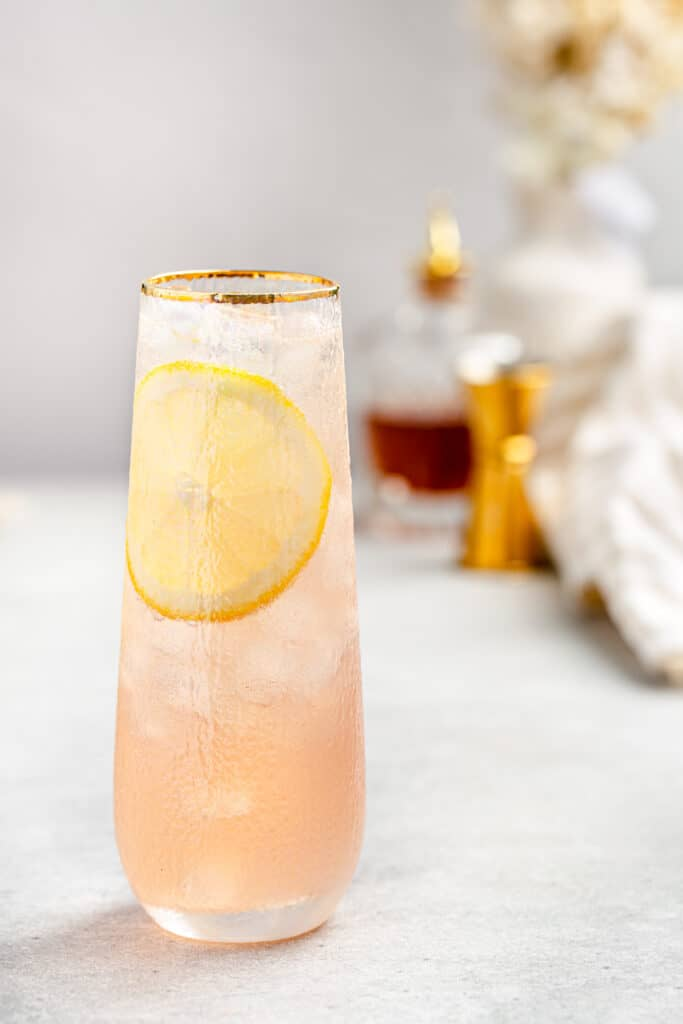 close up of lillet gin cocktail with lemon slice