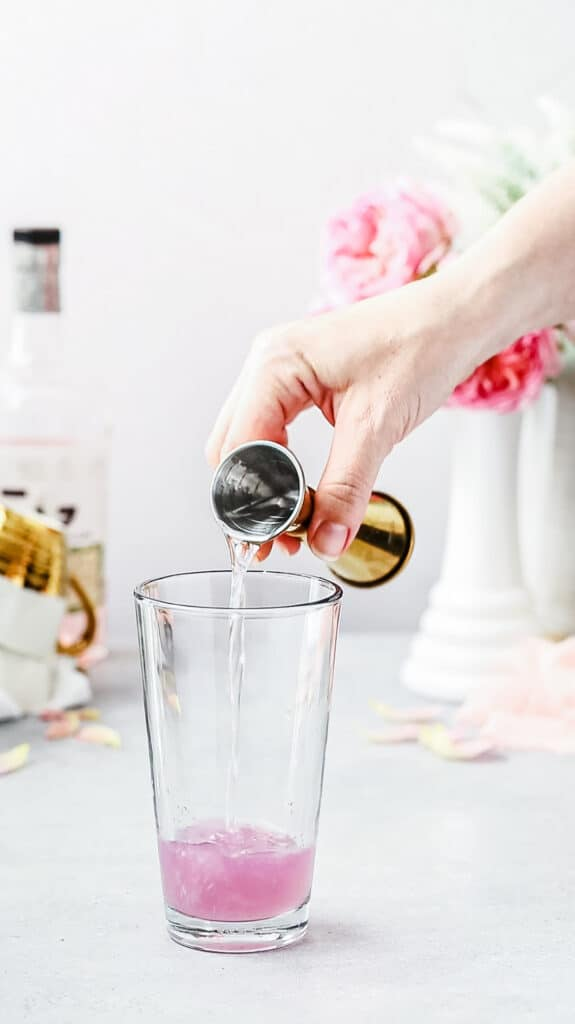 pouring simple syrup into cocktail shaker