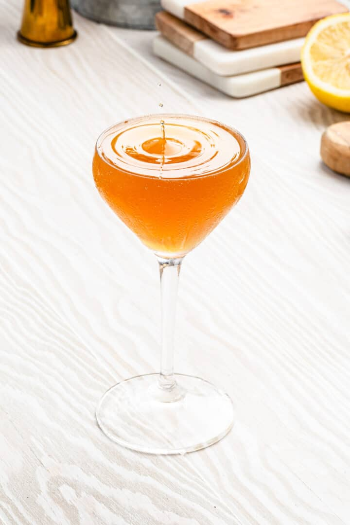 top view of cocktail with droplet splashing into it