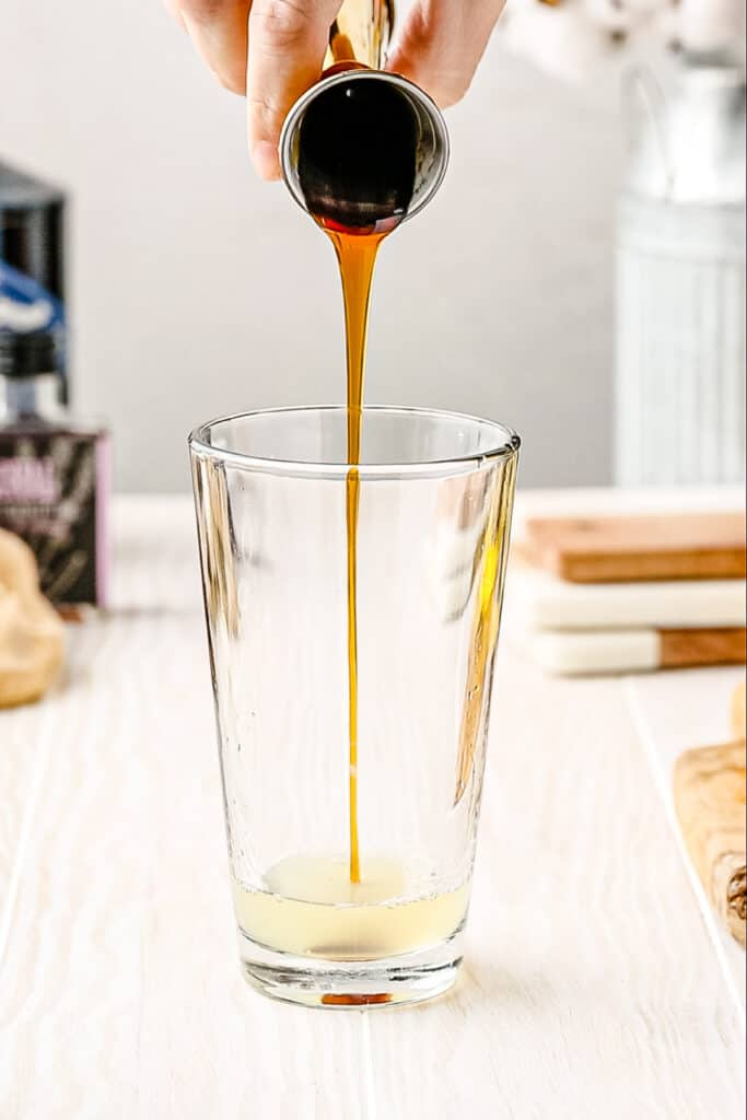 adding honey to cocktail