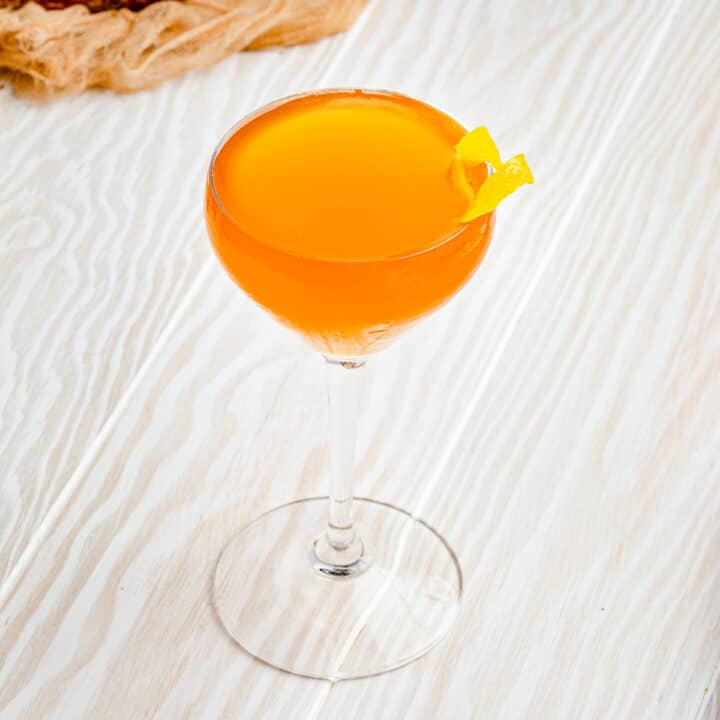 top view of bees knees cocktail with lemon peel garnish
